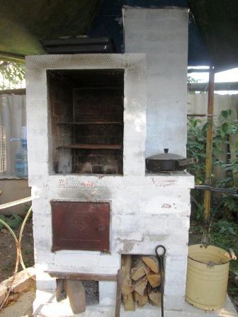 Уличная печь коптильня в работе. Регулировка топочного режима.